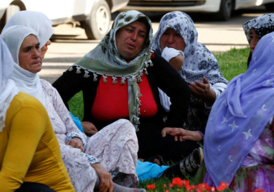 Women mourn as they wait in front of a hospital morgue in the Turkish city of Gaziantep, after a suspected bomber targeted a wedding celebration in the city, Turkey