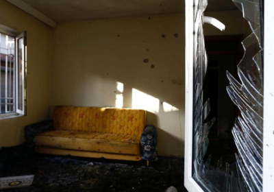 A damaged house is seen after a suspected suicide bomber targeted a wedding celebration in the Turkish city of Gaziantep